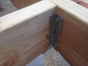 This is a joist hanger.  I had never used them before.