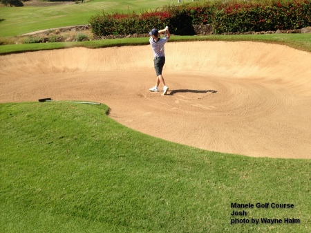 Josh hitting out of a fairway bunker on the 9th hole on the Manele Golf Course on Lanai.
